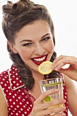 A retro-stlye girl drinking lemonade