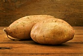 Two Sweet Potatoes on Wooden Table