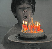 A boy with a birthday cake (alienated)
