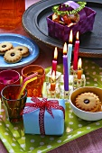 Birthday cakes, candles and jam biscuits