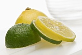 A sliced lemon and a sliced lime