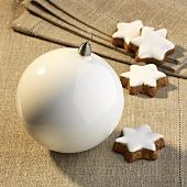 Cinnamon stars and white a Christmas bauble