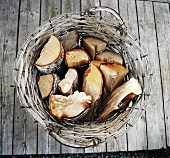 Firewood in a willow basket, seen from above