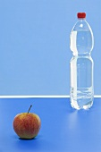 An Elstar apple and a bottle of mineral water