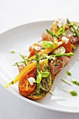 Baguette with ham, grilled vegetables and pesto