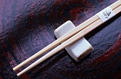 Wooden chopsticks with a chopstick rest