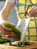 Cucumber being sliced