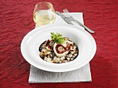 Mushroom risotto with beef roulade