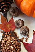 Roasted Kasha in a Wooden Spoon; Autumn Leaves, Acorns and Pumpkin