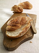 Country bread on a chopping board