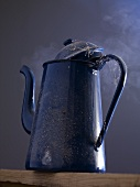 An old coffee pot steaming