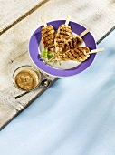Grilled chicken satay kebabs with a peanut dip