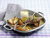 Lamb meat balls on skewers with potato wedges