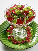 Red and green sweets in a glass bowl