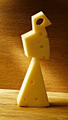 A tower of cheese pieces