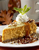 Slice of Pumpkin Cheesecake with Whipped Cream