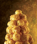 Croquembouche (profiterole pyramid with caramel sauce, France)