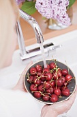 Cherries being washed in a bowl