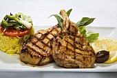 Grilled pork chops with rice and vegetables
