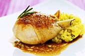 Leg of guinea fowl with mashed potatoes, lemons and olives