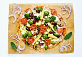A colourful pizza with corn cobs