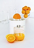 Freshly pressed orange juice with a juicer