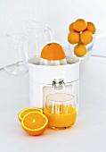 Freshly pressed orange juice with a juicer