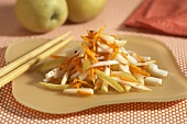 Asian Pear and Shredded Carrot Salad on a Plate; Chopsticks