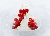Yogurt ice cream garnished with redcurrants