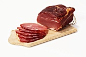 Cured pork loin on a cutting board