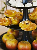 Saffron pastries and apples on a cake stand