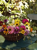 A summery bouquet in a willow basket