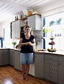 Woman in her kitchen peeling pears