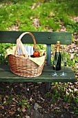 Picnic basket with champagne bottle and glasses