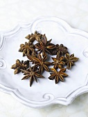 Star anise on a white surface