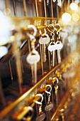 Lots of hotel keys on hooks
