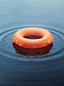 Life preserver on the surface of the water