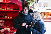 Couple drinking punch at a Christmas market