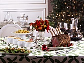 Christmas table with roast prime rib and side dishes