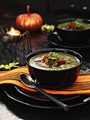 Green cream of vegetable soup at Halloween