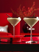 Two cream cocktails in Martini glasses