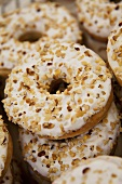 Iced donuts sprinkled with chopped hazel nuts
