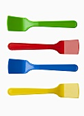 Four brightly colored ice cream spoons