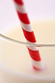 Glass of milk with a straw