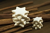 Stacked cinnamon stars on cinnamon sticks