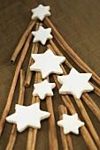 Cinnamon sticks forming the shape of a Christmas tree with cinnamon stars on top