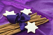 Cinnamon stars with cinnamon sticks wrapped with purple ribbon