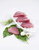 Fresh tuna fillets, garlic and rosemary