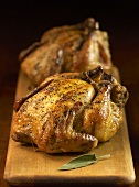 Whole Roasted Stuffed Cornish Game Hens; On Cutting Board