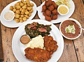 Southern Soul Food; Hush Puppies, Red Beans and Rice, Fried Chicken and Gravy with Mashed Potatoes and Collard Greens,Fried Okra